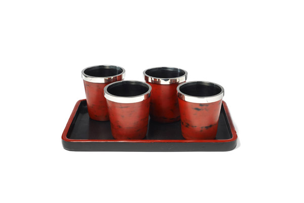 Lacquer cups with silver rims on a lacquer tray