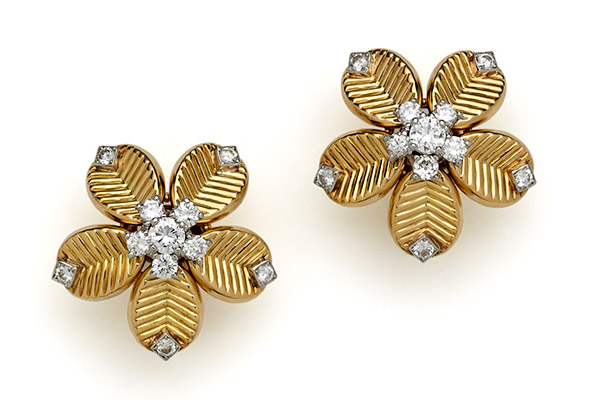 Cartier, gold and diamond 'Coffee Bean' earclips, circa 1955.